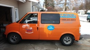 Water Damage Restoration Van At Winter Residential Job Area