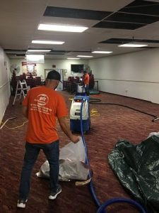 Technicians Conducting Flood Cleanup In A Commercial Property