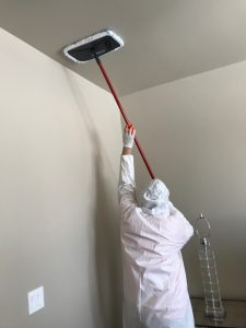 Our Technician Cleaning Ceiling Water Damage and Mold